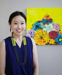 Suzy Taekyung Kim poses with a recent painting