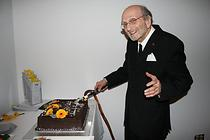 Abraham Rogatnick cutting his birthday cake, November 27, 2007