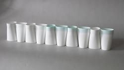 "Image 2: ""Double-walled cup"". This slip-cast object was produced at the experimental design studio of Huaguang, Zibo, China. The object was designed so that its surface is a simple cylinder, which can also be continuous as multiple objects are lined up as a group."